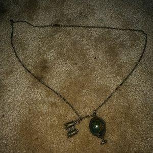 Rotating globe and binoculars necklace so cute